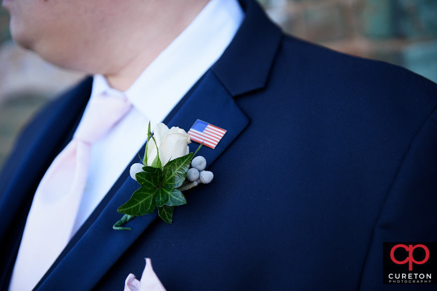 Grooms american flag pin.