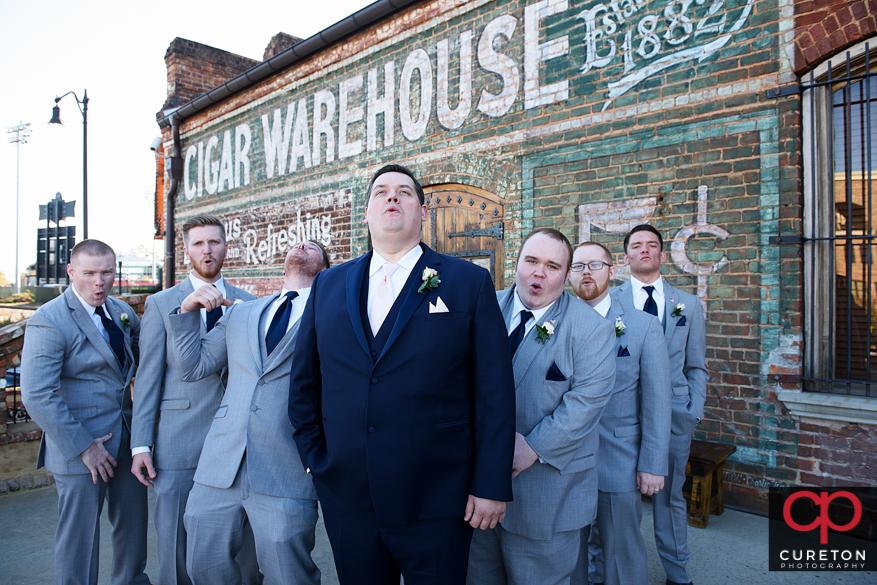 Groomsmen outside the Old Cigar Warehouse.
