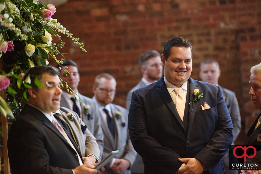 Groom sees bride for the first time.