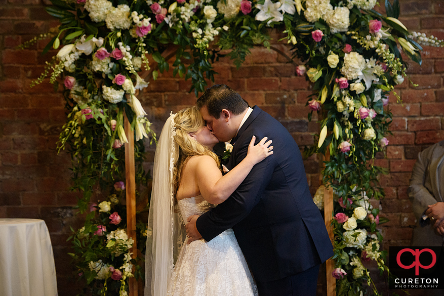 First kiss at wedding.