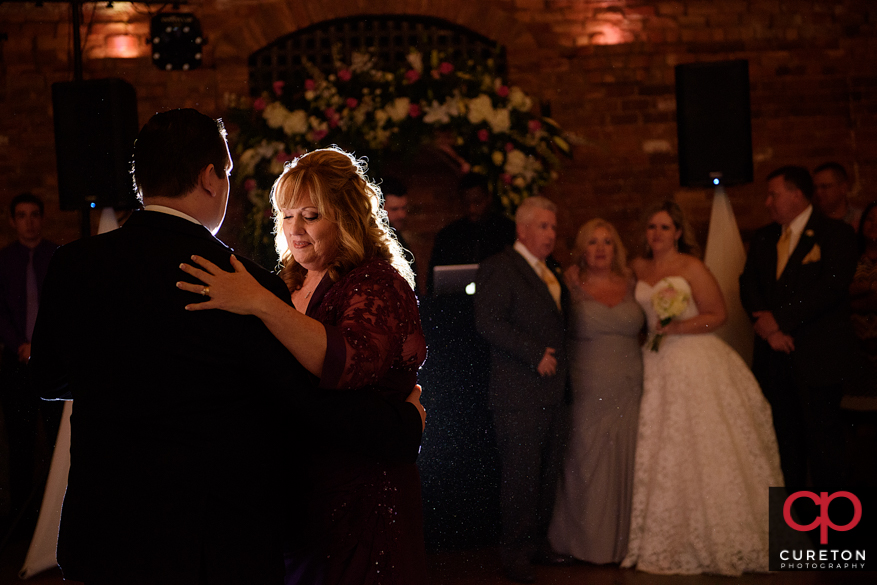 Groom dances with his mother.