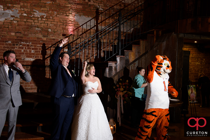 The bride and groom are joined by the Clemson Tiger for tiger rag at their wedding downtown.