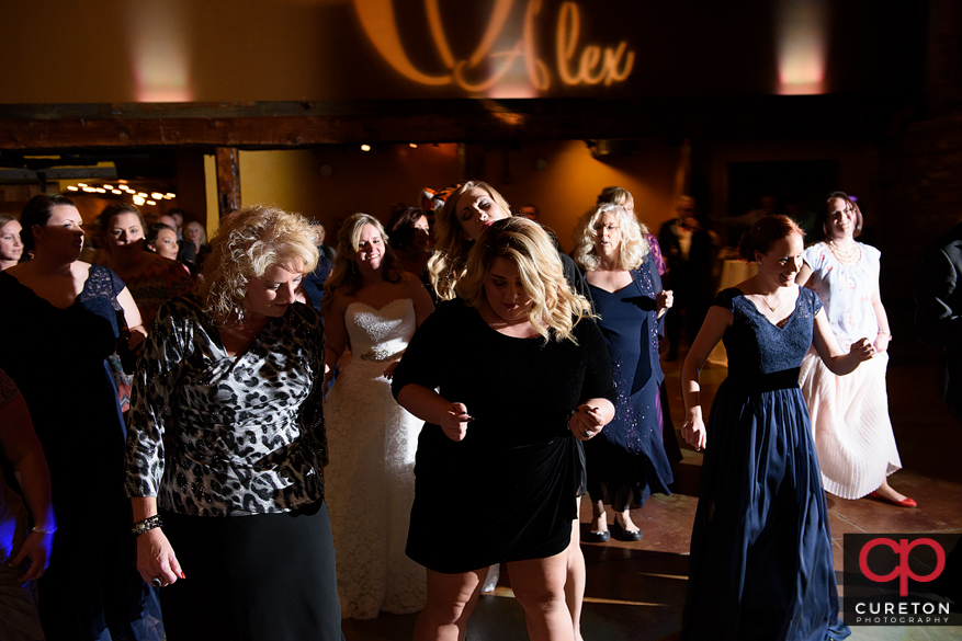 The wedding guests dance to Uptown Entertainment.