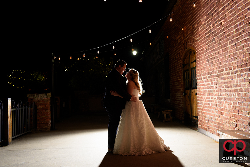 Bride and groom silhouette outside OCW.