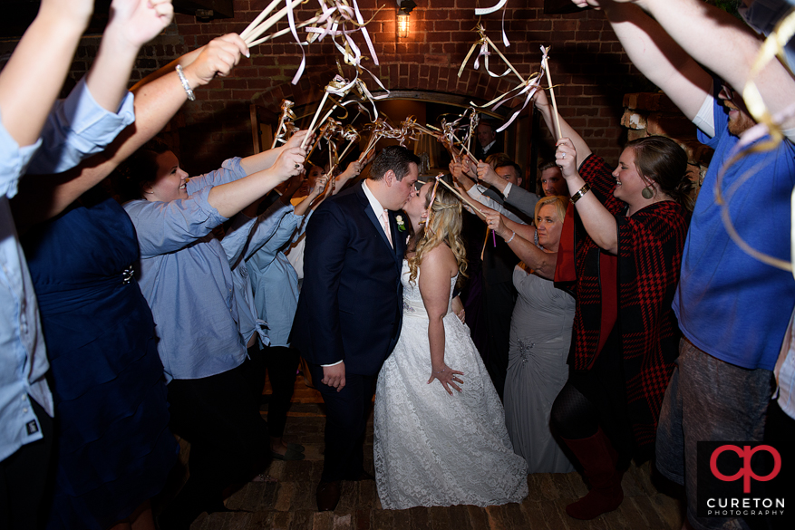 Bried and groom's grand exit though streamer wands.