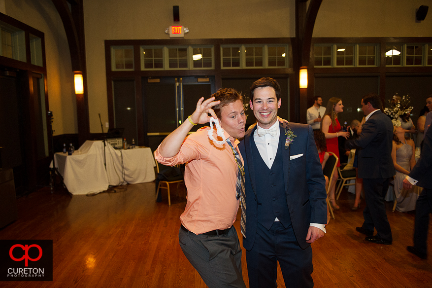 Groom and the guy who caught the garter.