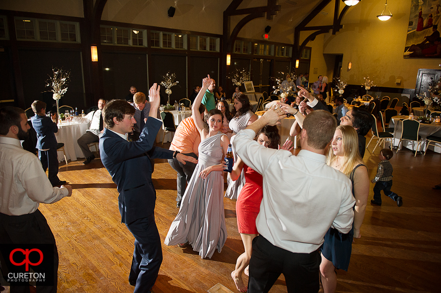 Guests dancing at the wedding reception at Cleveland Park in Spartanburg,SC.
