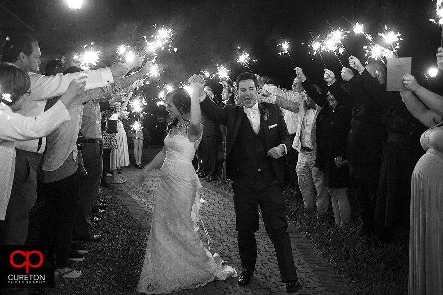 Bride and Groom exit their wedding.