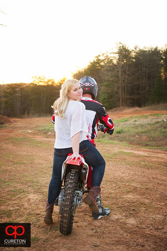 Girl on the back of a motorcycle during her engagement session.