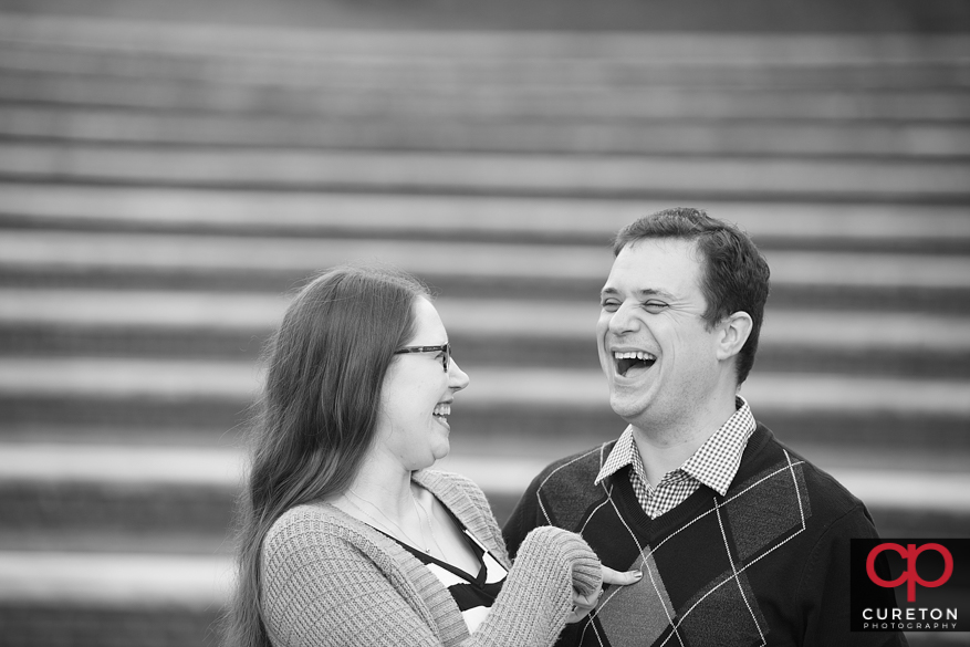 Future bride and groom sharing a laugh.