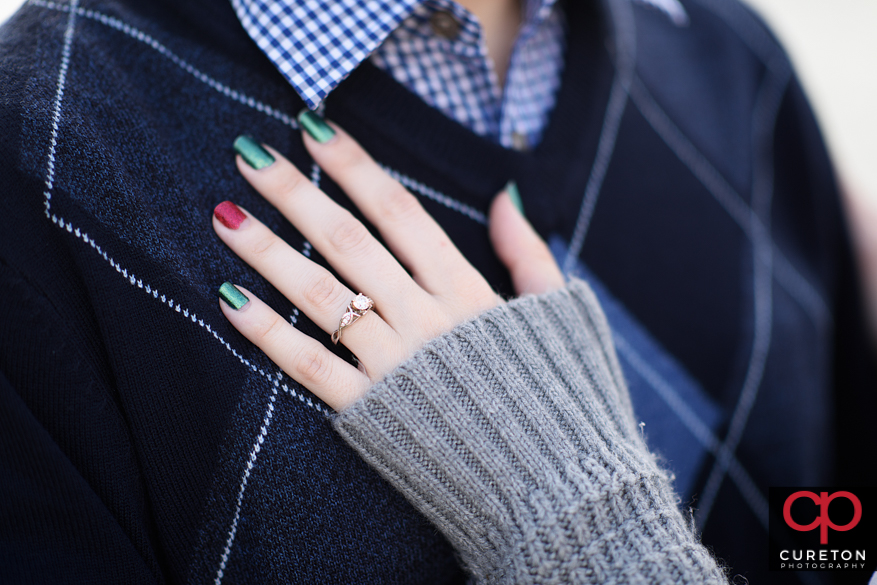 Closeup shot of wedding ring on bride's hand.