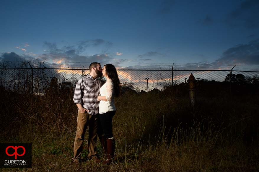 Couple at sunset during their engagement session on the Swamp Rabbit Trail in Greenville,SC.
