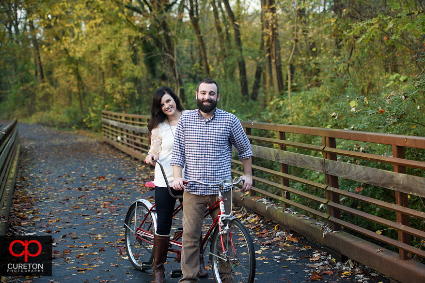 Man and woman on a tandem bicycle on the Swamp Rabbit Trail.