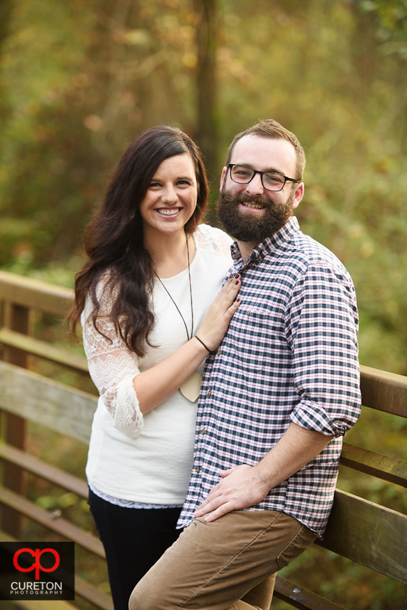 Engaged couple on the Swamp Rabbit Trail.