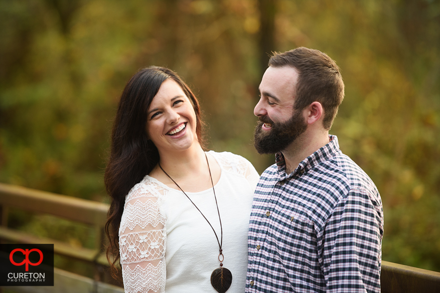 Couple laughing during a fall engagement session.