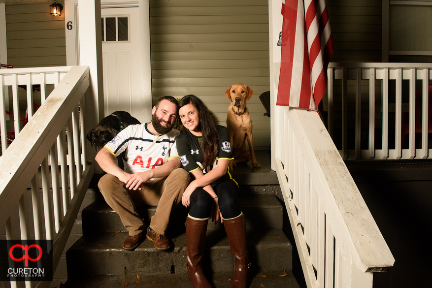 Engaged couple and their dogs.