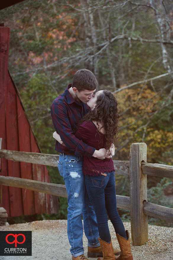 Newly engaged couple celebrating the proposal at Campbell's covered Bridge in Greer,SC.
