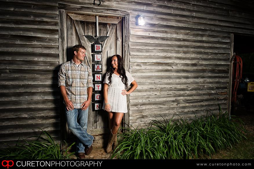 Engagement photo at a rustic barn.