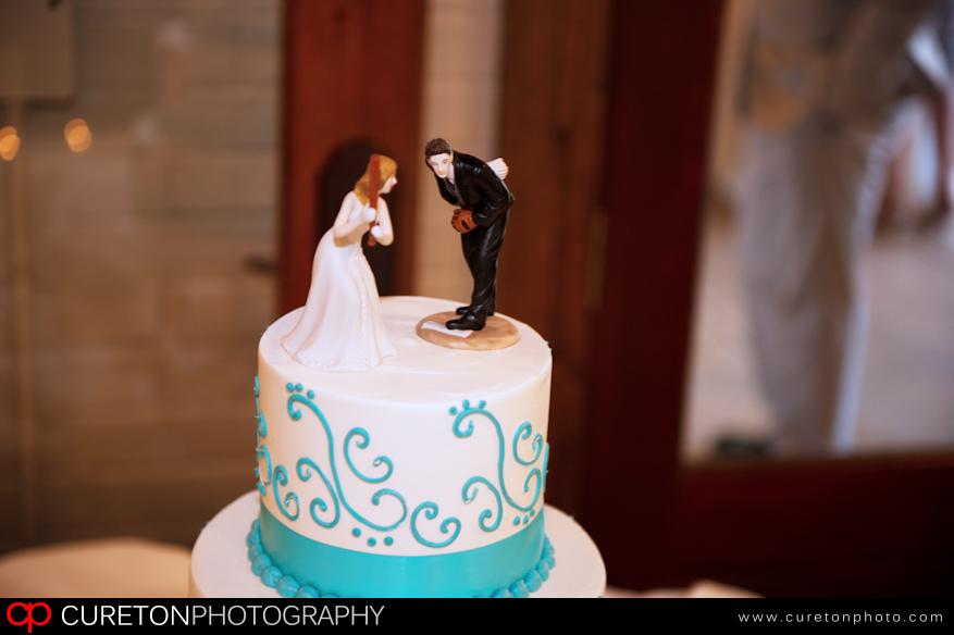 Baseball wedding cake topper.