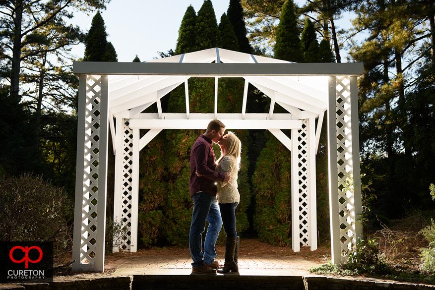 Gazebo kiss at a Botanical Garden engagement session in Clemson,SC.