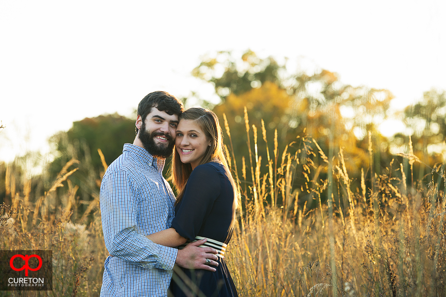 Couple cheek to cheek during their Botanical Gardens engagement session in Clemson,SC..