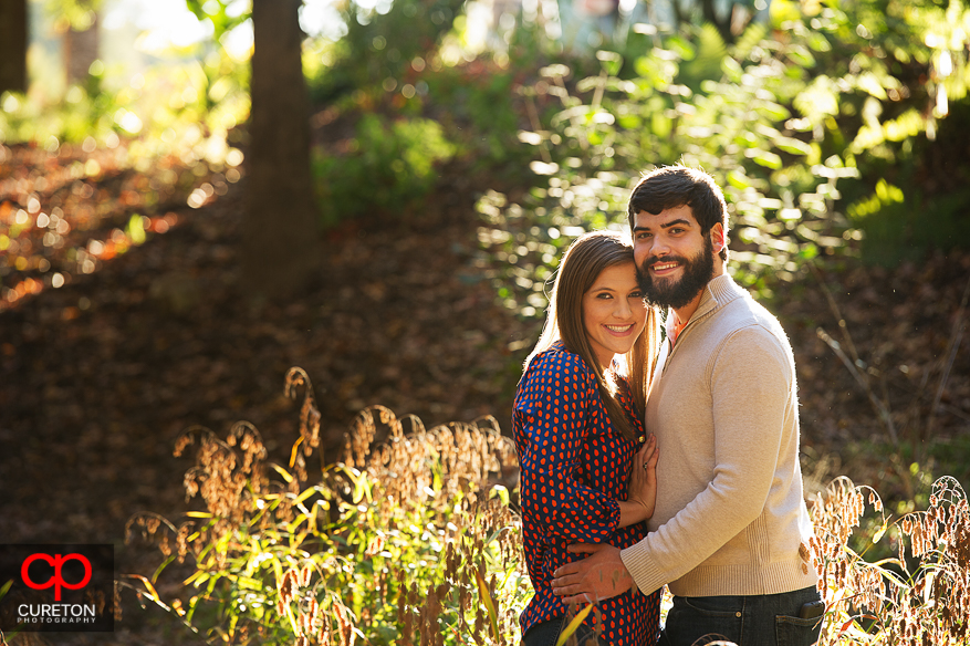 Couple in amazing light during their Botanical Gardens engagement session in Clemson,SC..