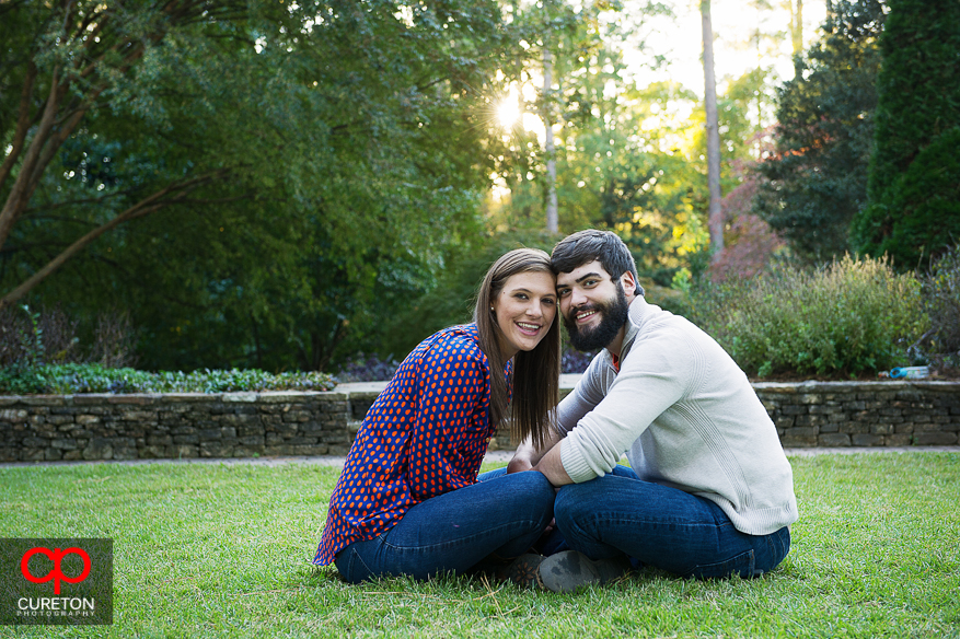 Couple sitting face to face at the Botanical Gardens in Clemson.