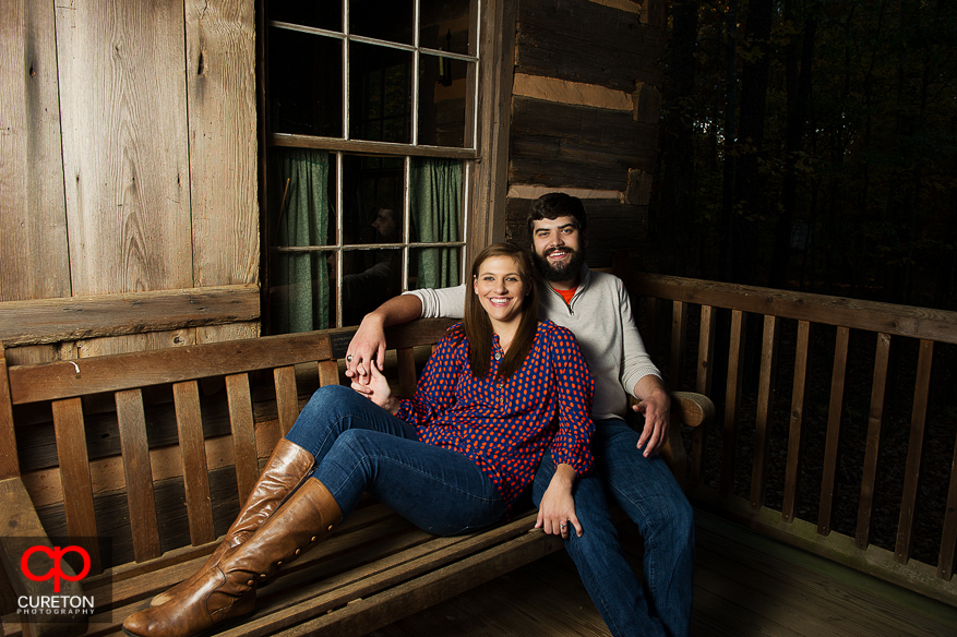 Couple at the Hunter cabin during their Botanical Gardens engagement session in Clemson,SC..