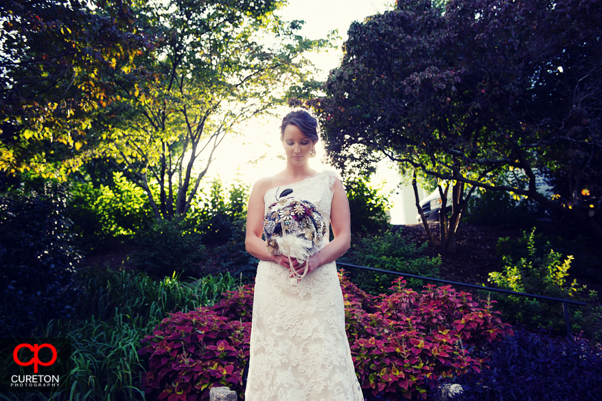 Bride with glowing sun and flowers.