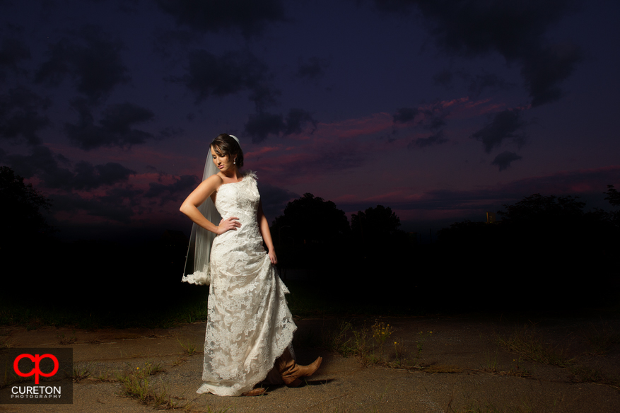 Very fashion forward pose of bride at sunset.