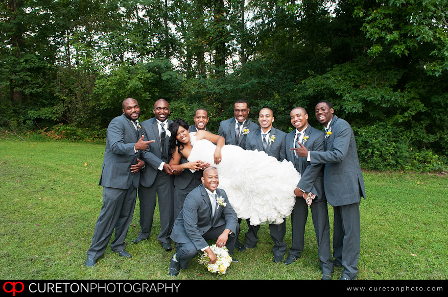 The bride with all of the groomsmen.