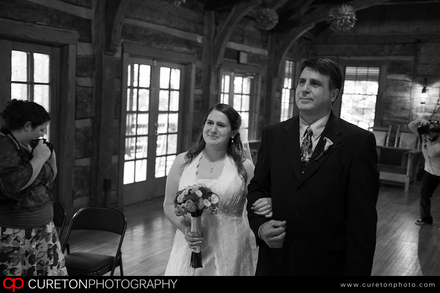 Bride walking down the aisle with her father.