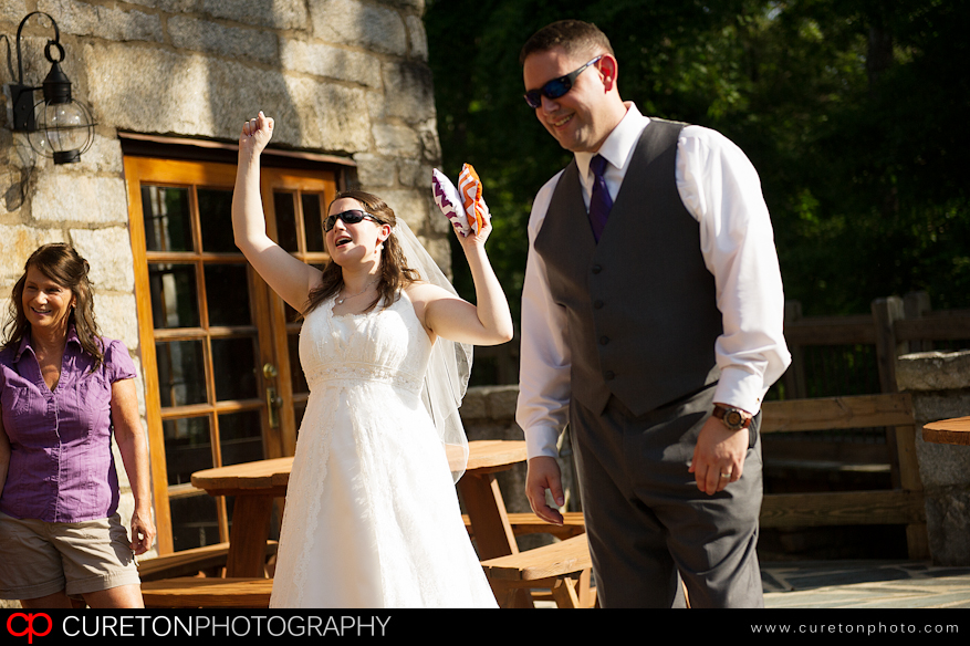 Bride and Groom playing corn hole at their wedding.