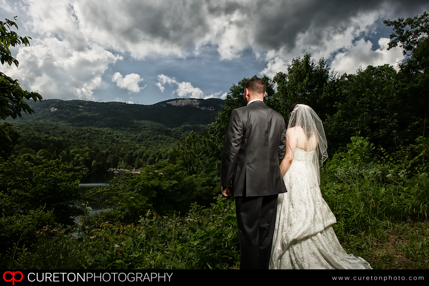 Bride and Groom looking at table rock after their wedding.