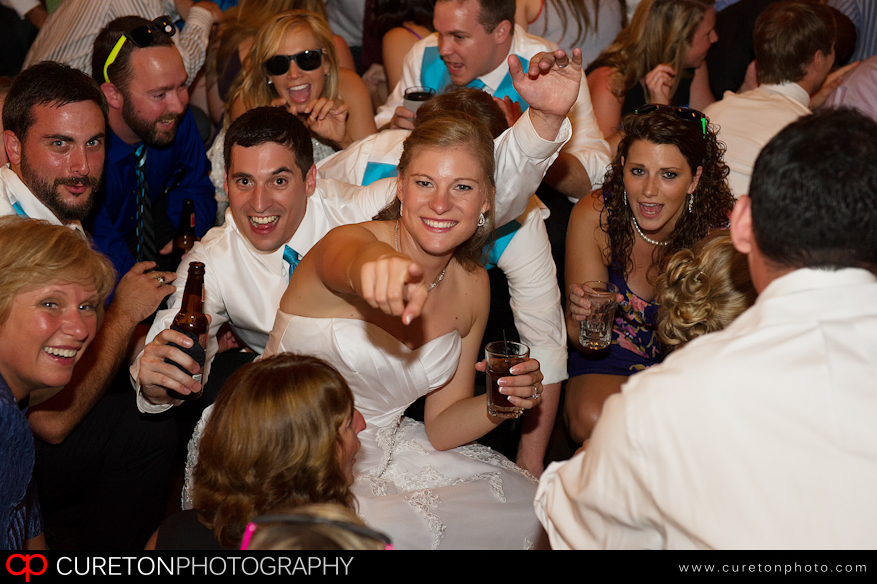 Bride and Groom in the middle of a crowd.