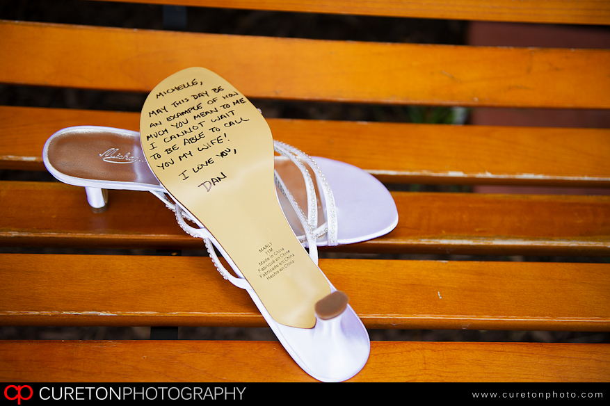 Bride with writing on shoes.