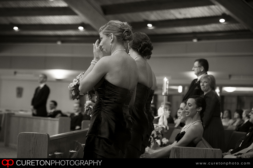 Bridesmaids crying at wedding.