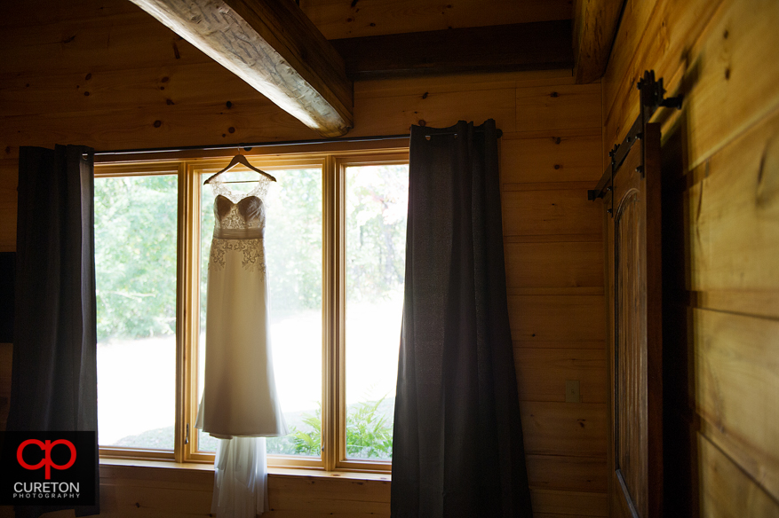 Brides dress hanging in the cabin.