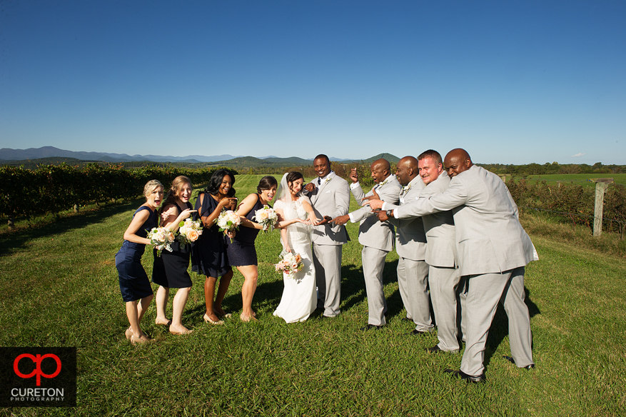 Creative wedding party pose at Chattooga Belle Farm.