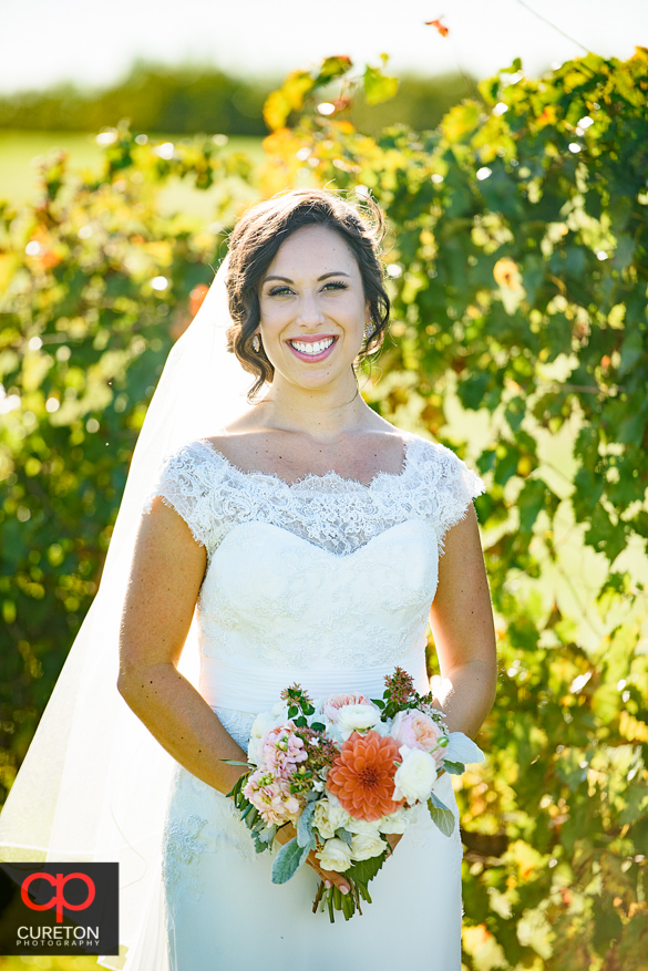 Beautiful bride in the vineyard at Chattooga Belle Farm.