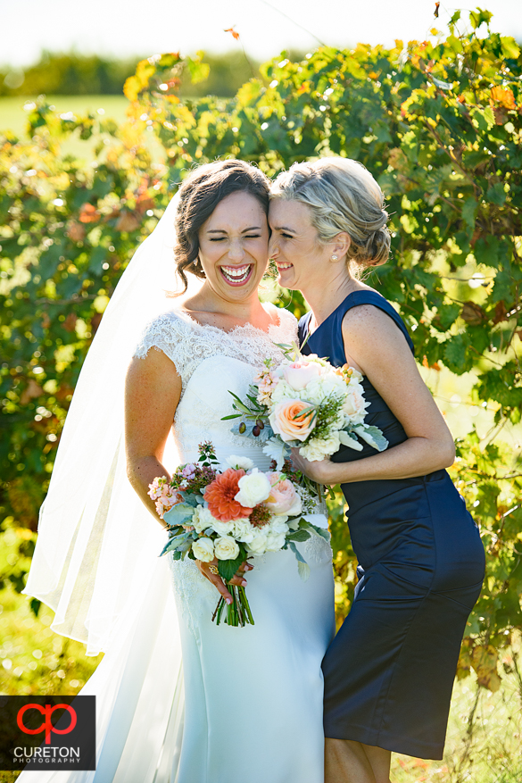 Beautiful bride and bridesmaid in the vineyard at Chattooga Belle Farm.