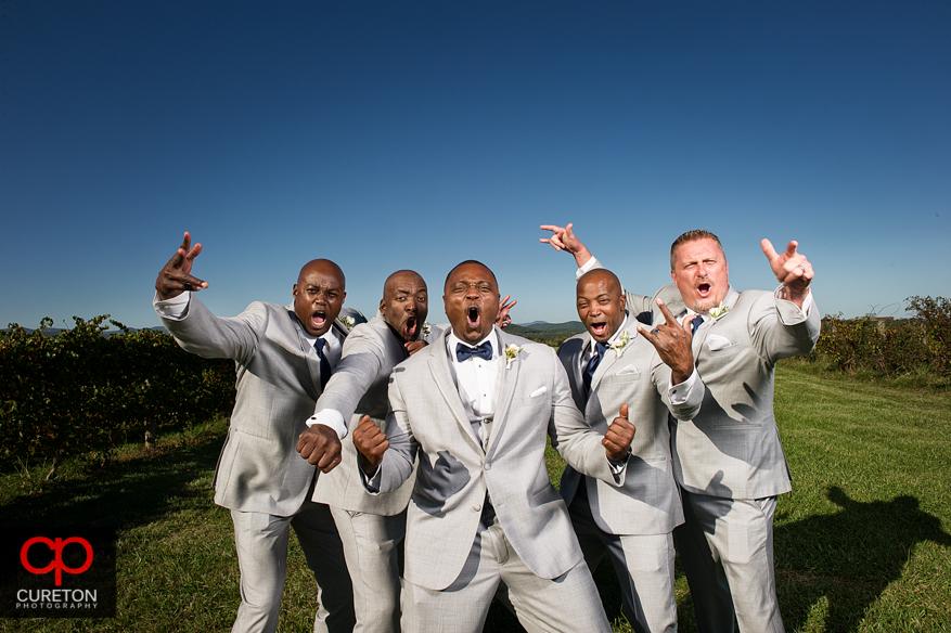 Epic creative groomsmen outside Chattooga Belle Farm.