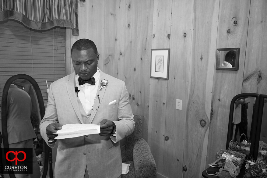 Groom reads letter from his bride.
