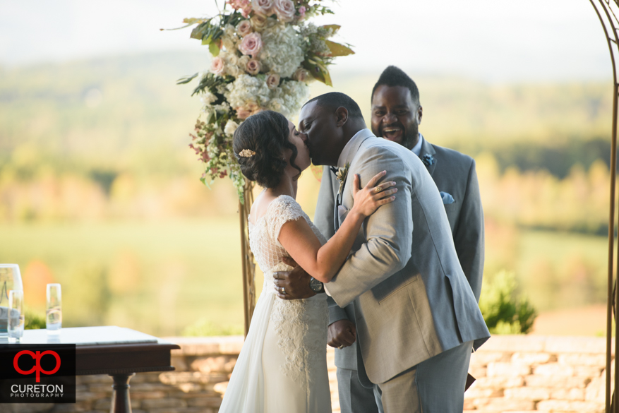 First Kiss after thier Chattooga Belle Farm wedding.