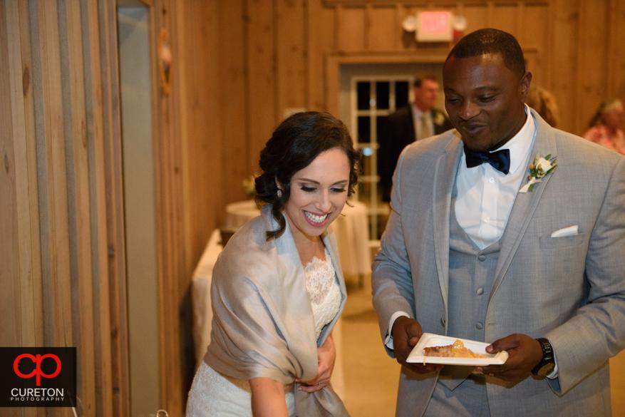 Bride and groom cut a wedding cobbler.