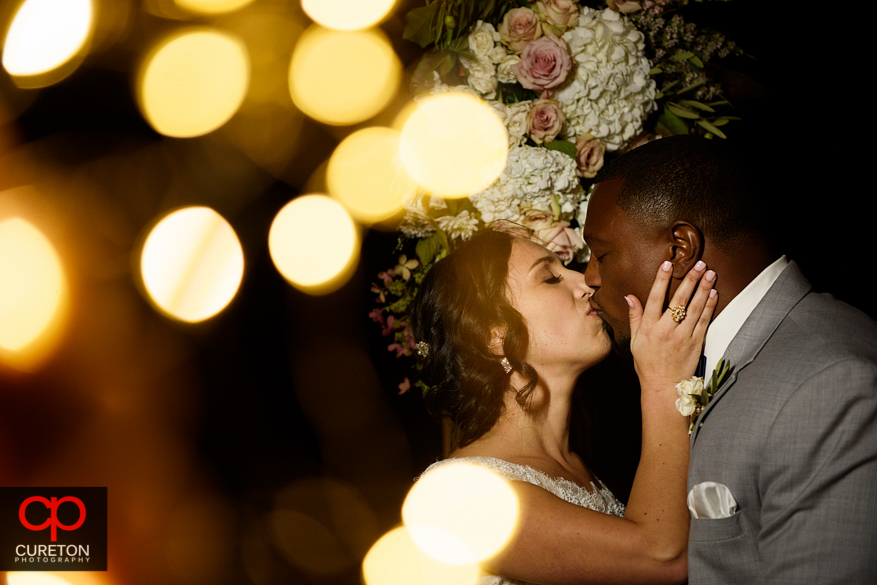 Bride and groom with twinkly lights.
