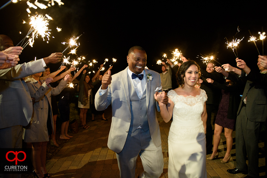 Bride and groom leaving though sparklers after a Chattooga Belle Farm wedding.
