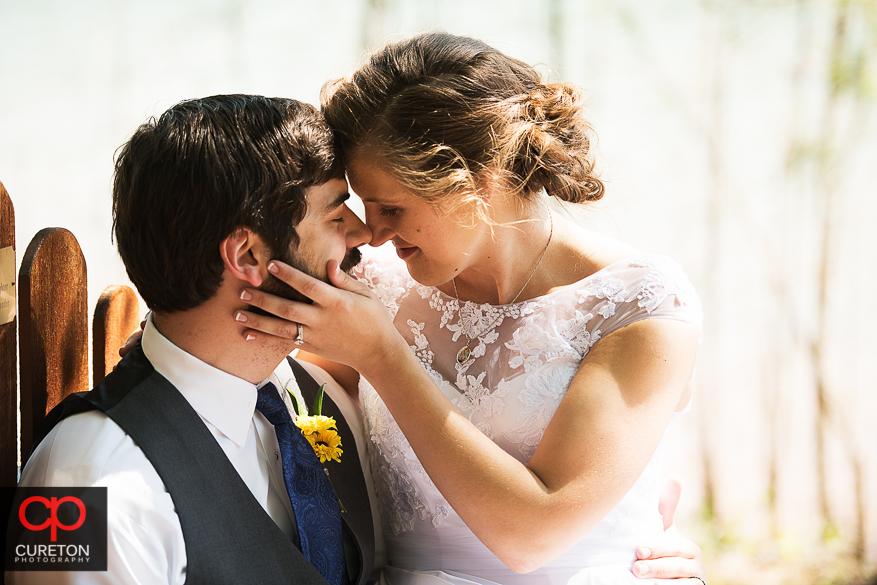 Bride and groom at Clemson Ooutdoor Lab.
