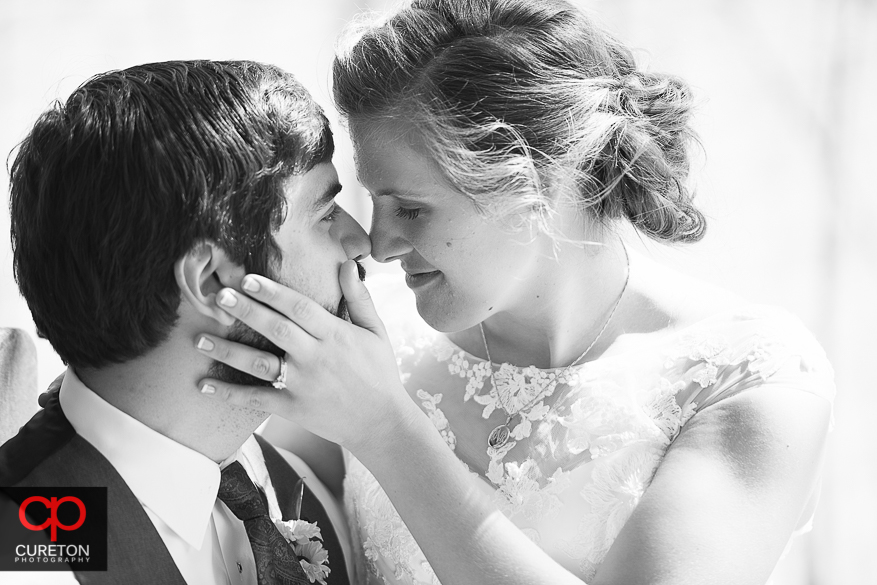 Bride touching the grooms face.