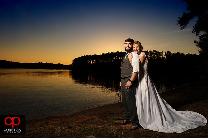 Bride and Graham posing under a Clemson,SC sunset.
